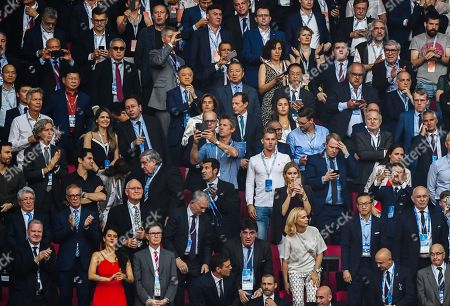 Liverpool Owner John W.Henry front row with his wife and Edwin van der Sar, Antonio Conte (left) Luis Figo, and Kaka amongst others