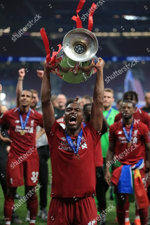 Daniel Sturridge of Liverpool celebrates with the Champions League Trophy at the end