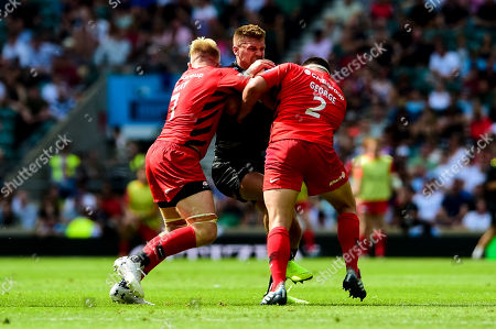 Henry Slade of Exeter Chiefs is challenged by Jackson Wray of Saracens and Jamie George of Saracens