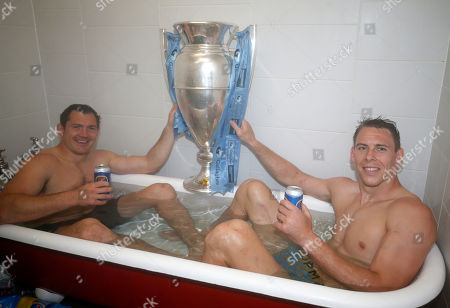 Liam Williams (right) and Alex Goode of Saracens with the Premiership Trophy in the bath