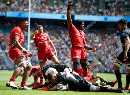 Saracens player Will Skelton, Alex Goode and Maro Itoje celebrate their 2nd Try, scored by Ben Spencer