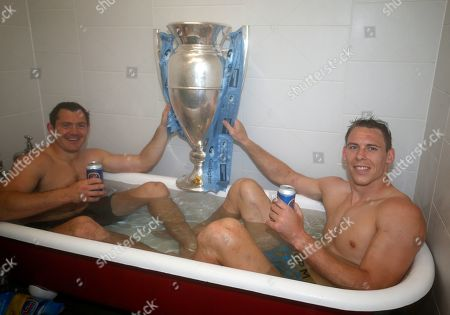 Liam Williams (right) and Alex Goode with the Premiership Trophy in the bath