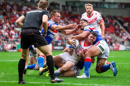 St Helens' Lachlan Coote is tackled by Wakefield's Keegan Hirst, Tyler Randall and Kelepi Tanginoa.