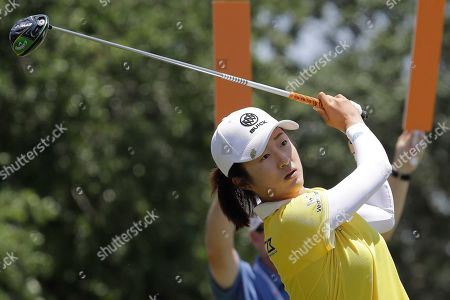 Yan Liu of China, hits off the first tee during the third round of the U.S. Women's Open golf tournament, in Charleston, S.C