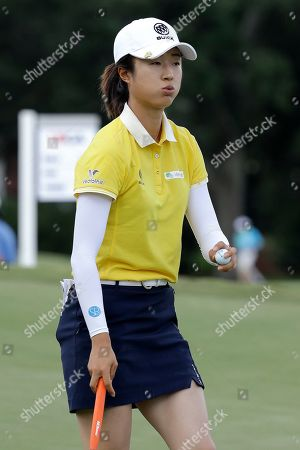 Yan Liu of China, walks on the fairway on the 16th hole during the third round of the U.S. Women's Open golf tournament, in Charleston, S.C