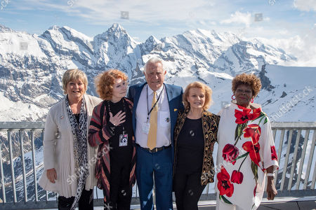 """Stock Picture of The James Bond actor George Lazenby, centre, with actress Jenny Hanley aka Irish Girl, Catherine Schell aka Nancy, left, Helena Ronee aka Israeli Girl, right, and Sylvana Henriques aka Jamaican Girl, from left, on the Schilthorn on the occasion of the anniversary event 50 years James Bond """"On Her Majesty's Secret Service"""" on the Schilthorn, Switzerland, 01 June 2019."""