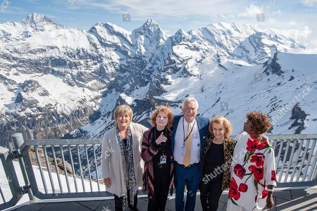 "The James Bond actor George Lazenby, centre, with actress Jenny Hanley aka Irish Girl, Catherine Schell aka Nancy, left, Helena Ronee aka Israeli Girl, right, and Sylvana Henriques aka Jamaican Girl, from left, on the Schilthorn on the occasion of the anniversary event 50 years James Bond ""On Her Majesty's Secret Service"" on the Schilthorn, Switzerland, 01 June 2019."