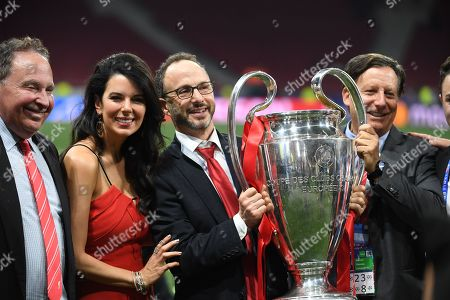 (from 2nd L) Linda Pizzuti Henry, wife of Liverpool owner John W. Henry, Michael Gordon, president of Fenway Sport Group and Liverpool chairman Thomas Werner pose with the trophy after the UEFA Champions League final between Tottenham Hotspur and Liverpool FC at the Wanda Metropolitano stadium in Madrid, Spain, 01 June 2019. Liverpool won 2-0.
