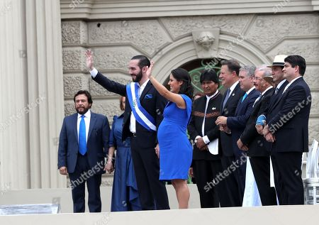 Nayib Bukele (C-L) greets with his wife Gabriela Rodriguez (C) after assuming the presidency of El Salvador for the period 2019-2024, in the presence of the presidents of Bolivia, Evo Morales (6R); of Panama, Juan Carlos Varela (5R); of Colombia, Ivan Duque (4R); of the Dominican Republic, Danilo Medina (3R); of Guatemala, Jimmy Morales (2R) and of Costa Rica, Carlos Alvarado (R), during a ceremony held in the Plaza General Captain Gerardo Barrios, in the Historic Center of San Salvador, El Salvador, 01 June 2019. Bukele was sworn in before Quijano, who later imposed the presidential sash before hundreds of special guests, including seven presidents, and citizens.