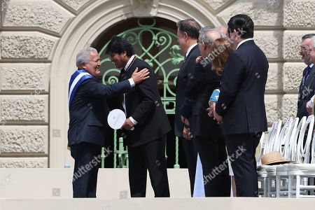 The outgoing president of El Salvador, Salvador Sanchez Ceren (L), greets the president of Bolivia, Evo Morales (2L), during the investiture ceremony of Nayib Bukele as the new president of El Salvador for the period 2019-2024, during a ceremony at the Plaza General Captain Gerardo Barrios, in the Historic Center of San Salvador, El Salvador, 01 June 2019.. Bukele was sworn in before the President of the Legislative Assembly, Norman Quijano, who later imposed the presidential sash before hundreds of special guests, including seven presidents, and citizens.