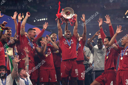 Liverpool's Daniel Sturridge lifts the trophy after winning the Champions League final soccer match between Tottenham Hotspur and Liverpool at the Wanda Metropolitano Stadium in Madrid