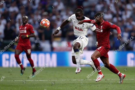 Tottenham's Moussa Sissoko fights for the ball against Liverpool's Daniel Sturridge during the Champions League final soccer match between Tottenham Hotspur and Liverpool at the Wanda Metropolitano Stadium in Madrid