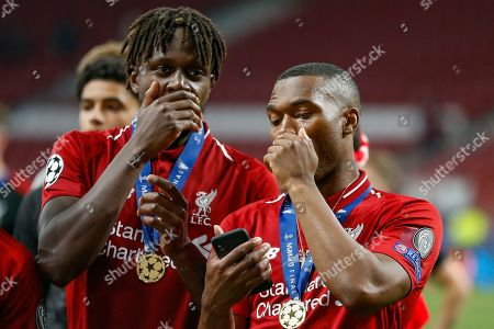 CHAMPIONS Holding their hands in front of their mouths, Liverpool forward Divock Origi (27) and Liverpool forward Daniel Sturridge (15), after the UEFA Champions League Final match between Tottenham Hotspur and Liverpool at Wanda Metropolitano Stadium, Madrid