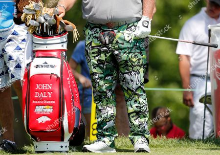 John Daly waits to hit off the third tee during the second round of the PGA Tour Champions Principal Charity Classic golf tournament, in Des Moines, Iowa