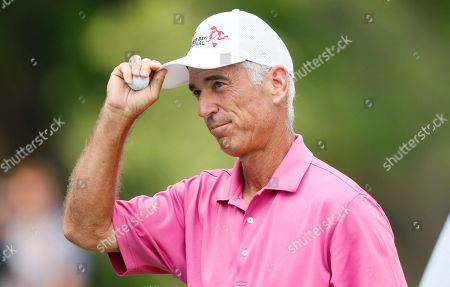 Stock Photo of Corey Pavin reacts after his putt on the 18th green during the second round of the PGA Tour Champions Principal Charity Classic golf tournament, in Des Moines, Iowa