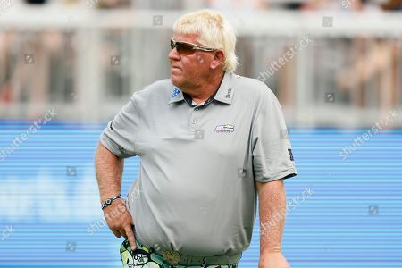Stock Image of John Daly waits to putt on the 18th green during the second round of the PGA Tour Champions Principal Charity Classic golf tournament, in Des Moines, Iowa