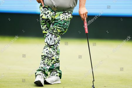 John Daly waits to putt on the 18th green during the second round of the PGA Tour Champions Principal Charity Classic golf tournament, in Des Moines, Iowa