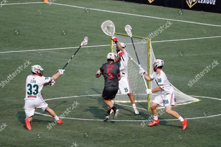 Chaos' Connor Fields shoots a goal past Whipsnakes' Kyle Bernlohr during a Premiere Lacrosse League game on in Foxborough, Mass