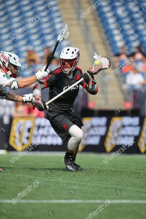 Chaos' Connor Fields runs with the ball during a Premiere Lacrosse League game on in Foxborough, Mass