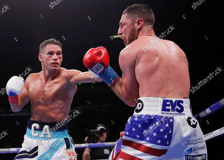 Chris Algieri, left, punches England's Tommy Coyle during the seventh round of a WBO boxing match, in New York. Algieri stopped Coyle in the eighth round