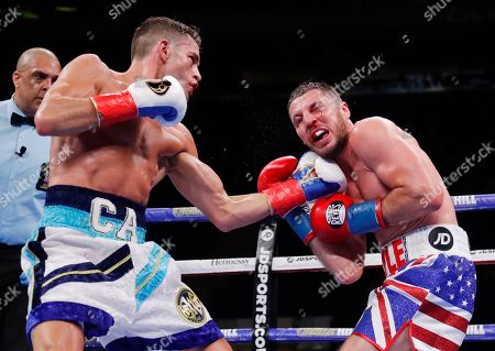 Chris Algieri, left, punches England's Tommy Coyle during the seventh round of a WBO super lightweight boxing bout, in New York. Algieri stopped Coyle in the eighth round