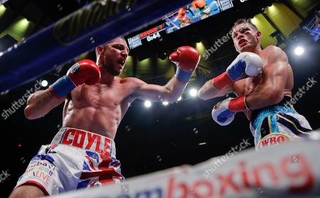 Stock Photo of England's Tommy Coyle, left, punches Chris Algieri during the seventh round of a WBO super lightweight boxing match, in New York. Algieri stopped Coyle in the eighth round