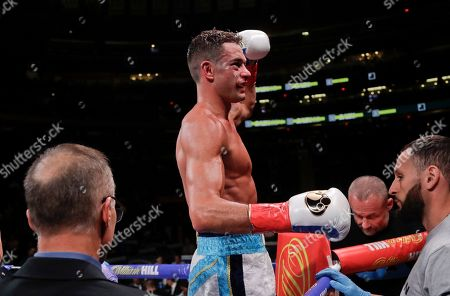 Stock Image of Chris Algieri celebrates after defeating England's Tommy Coyle in a WBO super lightweight boxing bout, in New York