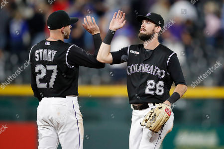Stock Photo of Trevor Story, David Dahl, r m. Colorado Rockies shortstop Trevor Story, left, and right fielder David Dahl congratulate one another after the team's baseball game against the Toronto Blue Jays, in Denver. The Rockies won 4-2
