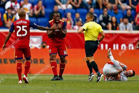 Real Salt Lake defender Nedum Onuoha (14) reacts as he is called for a foul on New York Red Bulls midfielder Marc Rzatkowski, right, by referee Armando Villarreal during the first half of an MLS soccer match, in Harrison, N.J