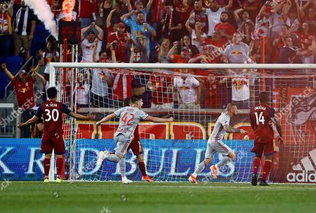New York Red Bulls midfielder Daniel Royer, second from right, celebrates his goal, near Real Salt Lake defender Nedum Onuoha (14) during the second half of an MLS soccer match, in Harrison, N.J