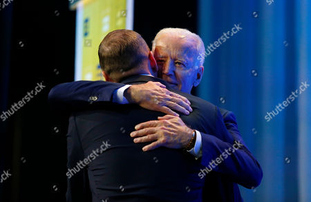 Democratic presidential candidate, former Vice President Joe Biden, right, embraces Human Rights Campaign president Chad Griffin during the Human Rights Campaign Columbus, Ohio Dinner at Ohio State University