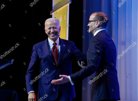 Human Rights Campaign president Chad Griffin, right, introduces Democratic presidential candidate, former Vice President Joe Biden during the HRC Columbus, Ohio Dinner at Ohio State University