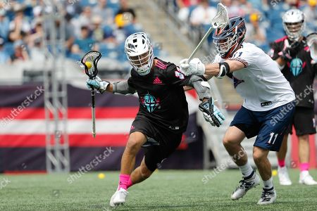 Chrome's Jordan Wolf runs with the ball against the defense of Archers' Matt McMahon during a Premiere Lacrosse League game on in Foxborough, Mass