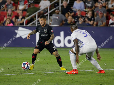 D.C. United Midfielder (10) Luciano Acosta works the ball in front of San Jose Earthquakes Defender (31) Harold Cummings during an MLS soccer match between the D.C. United and the San Jose Earthquakes at Audi Field in Washington DC