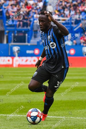 Montreal Impact defender Bacary Sagna (33) runs in control of the puck during Orlando City SC at Montreal Impact game at Saputo Stadium in Montreal, QC