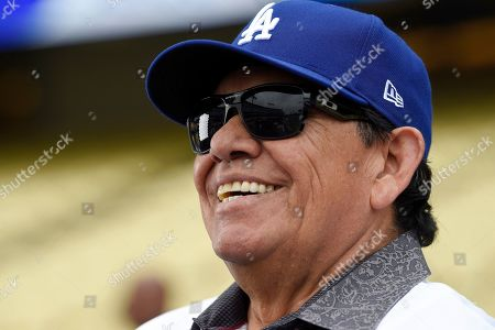 Former Los Angeles Dodgers pitcher Fernando Valenzuela gives an interview prior to a Dodgers alumni baseball game, in Los Angeles