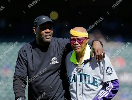 Stock Picture of Gary Payton, Slick Watts. Former Seattle Supersonics Gary Payton, left, and Slick Watts, right, walk on the field before a baseball game between the Seattle Mariners and the Los Angeles Angels, in Seattle. The former NBA team was honored on the 40th anniversary of winning the NBA championship in 1979