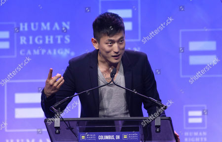 Actor Jake Choi speaks to guests after receiving the Visibility Award during the Human Rights Campaign Columbus, Ohio Dinner at Ohio State University