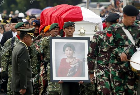 Stock Photo of Indonesian soldiers carry the coffin of former Indonesian First Lady Ani Yudhoyono during her funeral ceremony at the National Hero cemetery in Jakarta, Indonesia, 02 June 2019. Ani Yudhoyono, the wife of former Indonesian President Susilo Bambang Yudhoyono, passed away on 01 June 2019, aged 66, at the National University Hospital in Singapore after losing her battle with blood cancer.