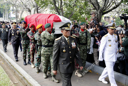 Stock Picture of Indonesian soldiers carry the coffin of former Indonesian First Lady Ani Yudhoyono during her funeral ceremony at the National Hero cemetery in Jakarta, Indonesia, 02 June 2019. Ani Yudhoyono, the wife of former Indonesian President Susilo Bambang Yudhoyono, passed away on 01 June 2019, aged 66, at the National University Hospital in Singapore after losing her battle with blood cancer.