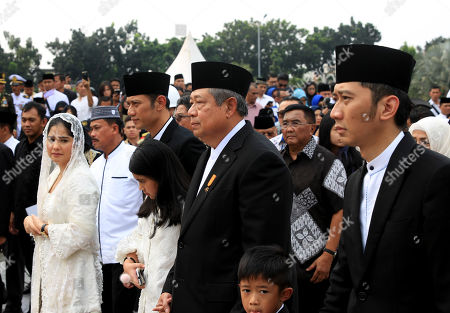 Stock Image of Former Indonesian president Susilo Bambang Yudhoyono (C), accompanied by sons and daughters, walks during his wife Kristiani Yudhoyono funeral ceremony at the National Hero cemetery in Jakarta, Indonesia, 02 June 2019. Ani Yudhoyono, the wife of former Indonesian President Susilo Bambang Yudhoyono, passed away on 01 June 2019, aged 66, at the National University Hospital in Singapore after losing her battle with blood cancer.