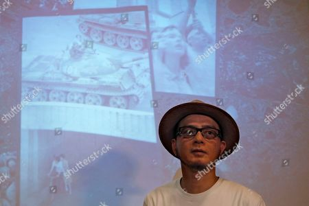 "Hong Kong singer Anthony Wong speaks during an interview in Hong Kong. Thirty years after it was crushed by China's army, the Tiananmen Square pro-democracy movement is being commemorated in art, literature, public rallies and even synth pop. Wong's latest release, ""Is it a crime,"" recorded with longtime musical partner Tats Lau is finding an audience by doing just that. The two make up the group Tat Ming Pair, long a staple of local music scene known as Cantopop for the Cantonese language in which the music is recorded"