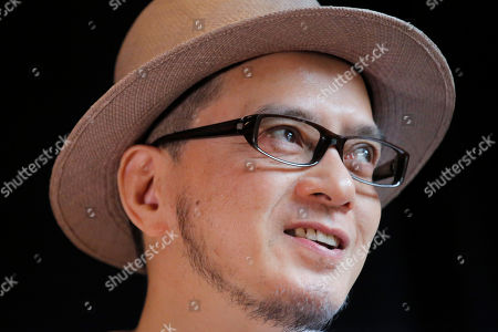 "Stock Picture of Hong Kong singer Anthony Wong speaks during an interview in Hong Kong. Thirty years after it was crushed by China's army, the Tiananmen Square pro-democracy movement is being commemorated in art, literature, public rallies and even synth pop. Wong's latest release, ""Is it a crime,"" recorded with longtime musical partner Tats Lau is finding an audience by doing just that. The two make up the group Tat Ming Pair, long a staple of local music scene known as Cantopop for the Cantonese language in which the music is recorded"