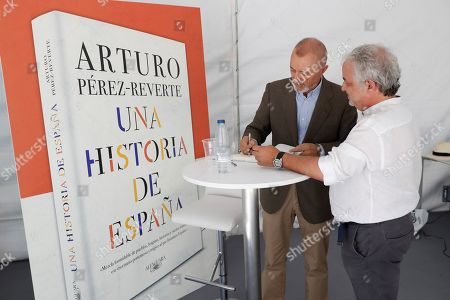 Spanish writer Arturo Perez-Reverte (L) signs books at the Book Fair in Madrid, Spain, 02 June 2019. The 78th edition of the Book Fair in Madrid is held from 31 May to 16 June 2019.