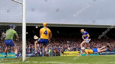 Clare vs Tipperary. Tipperary's Seamus Callanan scores his sides second goal despite goalkeeper Donal Tuohy, Seadna Morey and Patrick O'Connor of Clare