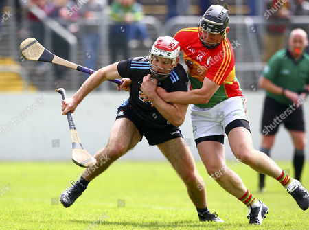 Carlow vs Dublin. Dublin's Paddy Smyth is tackled by Carlow's Seamus Murphy