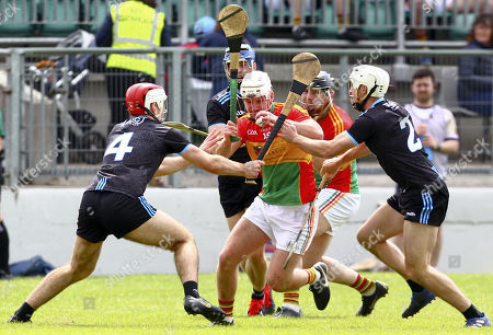 Carlow vs Dublin. Carlow's Seamus Murphy is tackled by Dublin's Paddy Smyth and Darragh O'Connell