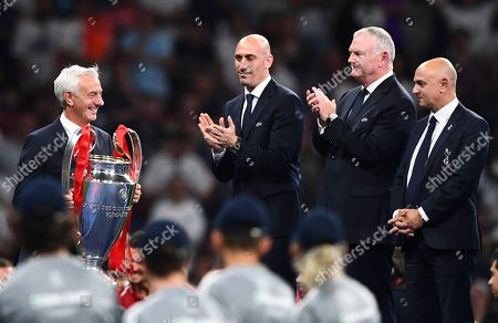 Ian Rush walks with the trophy past FA Chairman Greg Clarke and Tottenham Chairman Daniel Levy
