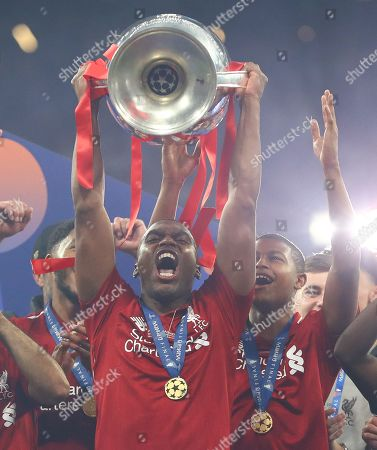 Daniel Sturridge of Liverpool lifts the Champions League trophy