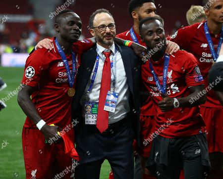 Stock Picture of Liverpool president Michael Gordon with Sadio Mane of Liverpool and Naby Keita celebrate at the end with the trophy